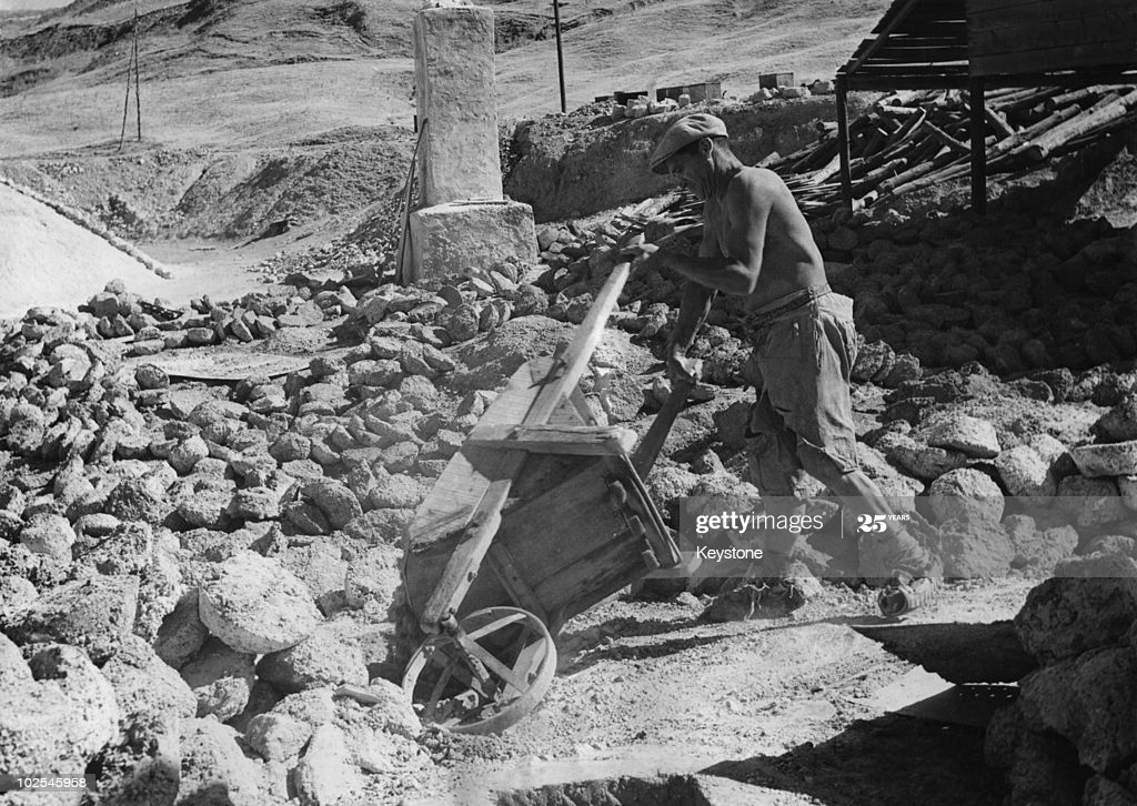 Black and white photo of a man working in a sulfur mine.