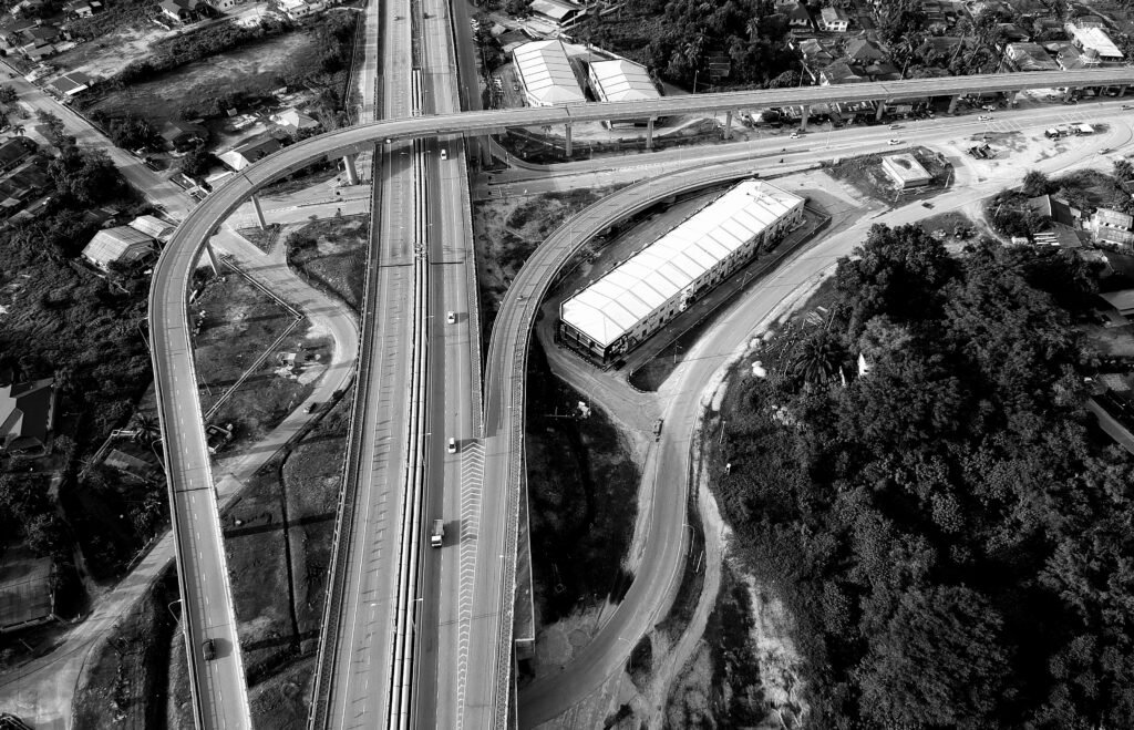 Aerial view of highways and overpass in black and white.